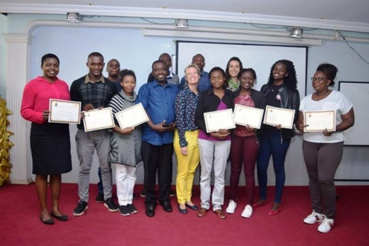 Students take a group photo after being awarded certificates
