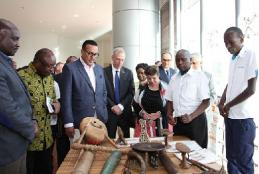 David Madanji (second right) of Iagas Material Culture Section shows guests some  items  that are part of the section's collection.